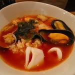 雑炊(トマトベースで魚貝類入り)