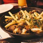 ツブ貝とポルチーニ茸のエスカルゴバター炒め
