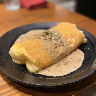 鉄板スフレオムレツ(ポルチーニ茸のクリームソース)